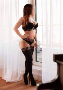 Escort Amelia she is staning in a black lace bra and stocking