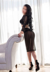 Long Island Escort Call Girl. Elena is wearing a black silky night gown.