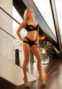 Escort jacqueline is weraing black lace panties and bra standing bu window